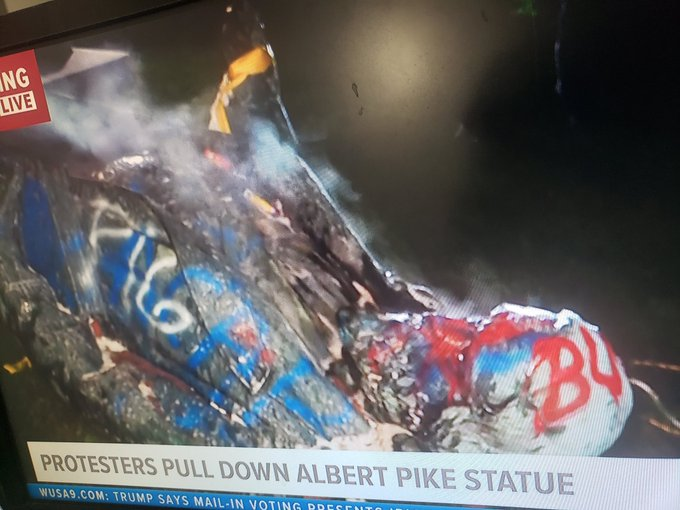 treason of albert pike addressed by protesters burning Pike's statue